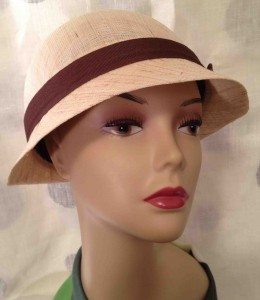 Molded woven hat with brown ribbon