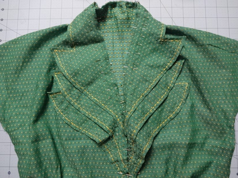 Collar pinned to front neck edge