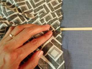 Inserting chopstick in pleat