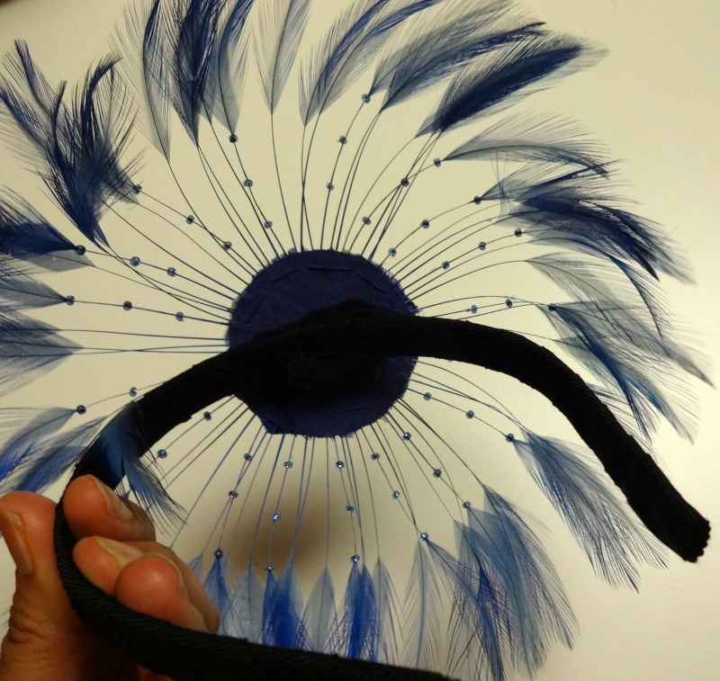 Feathered piece attached to headband - fascinator- csews.com