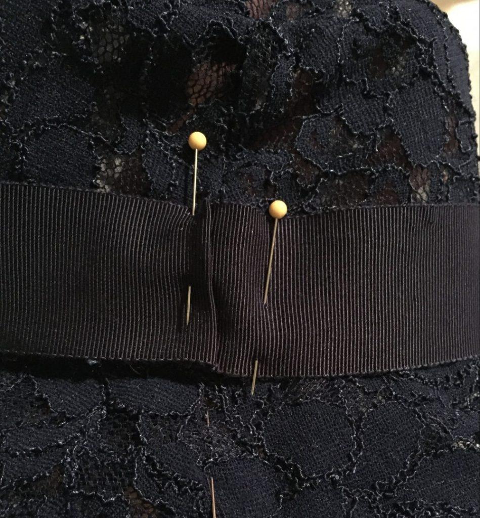 Pin Petersham ribbon to brim