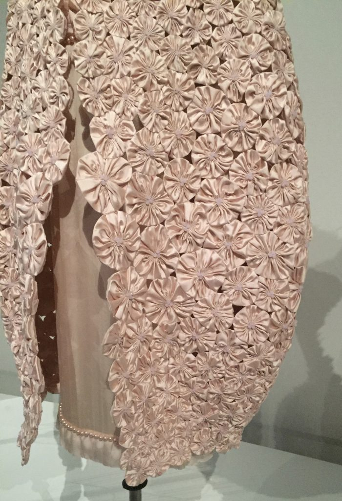 Manus x Machina - Chanel cape - 1,300 hand-pieced pink silk satin flowers by Lemarié with pink frosted crystals