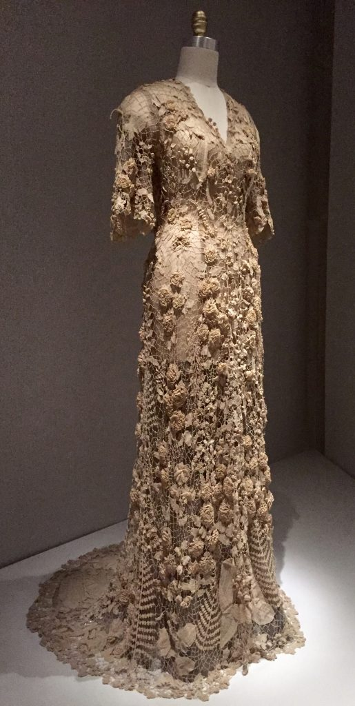 Manus x Machina - Irish wedding dress, ca. 1870 - hand-crocheted cotton lace with three-dimensional motifs (roses, lilies of the valley, hanging fuchsias, morning glories, buds and berries, and flat and folded leaves and ferns)