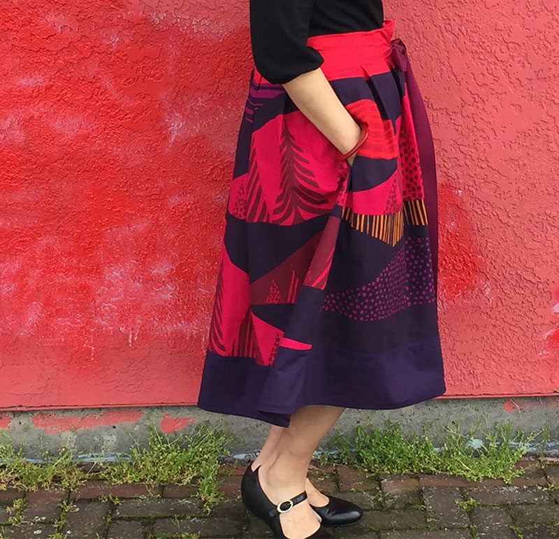 "Colorful skirt using Marimekko ""Tultakero"" fabric  - right view of skirt, hand in pocket - CSews.com"