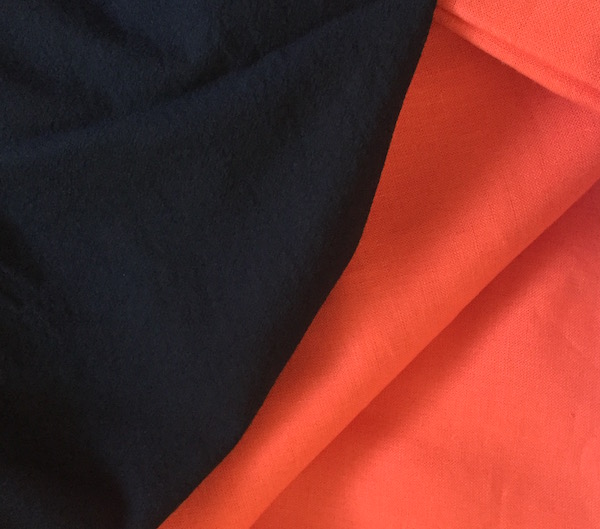 Dark blue cotton fabric on left, coral linen fabric on right