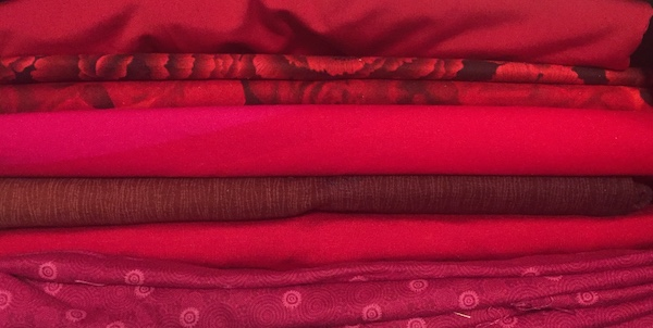 Stack of fabrics in shades of red